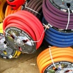 selection of garden hoses in bright colors