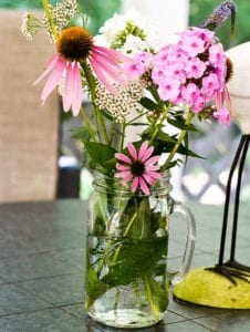 cone flower, phlox, yarrow in glass vase Colleen FlickrCC-SSA2.0