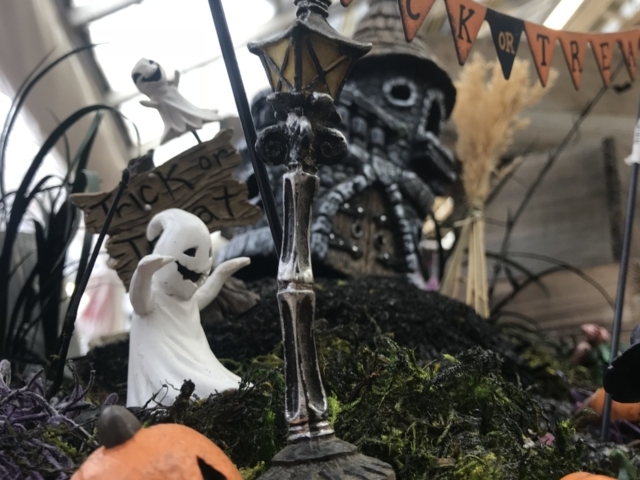 Halloween-themed fairy garden at city floral greenhouse and garden center