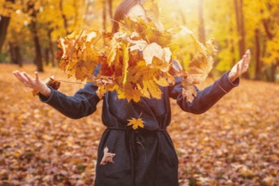 Throwing leaves in Autumn